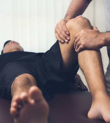 Therapist treating athlete for sports injury focus